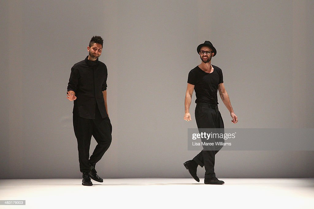 Designers Peter Strateas and <a gi-track='captionPersonalityLinkClicked' href=/galleries/search?phrase=Mario-Luca+Carlucci&family=editorial&specificpeople=848500 ng-click='$event.stopPropagation()'>Mario-Luca Carlucci</a> thank guests on the runway at the Strateas.Carlucci show during Mercedes-Benz Fashion Week Australia 2014 at Carriageworks on April 7, 2014 in Sydney, Australia.