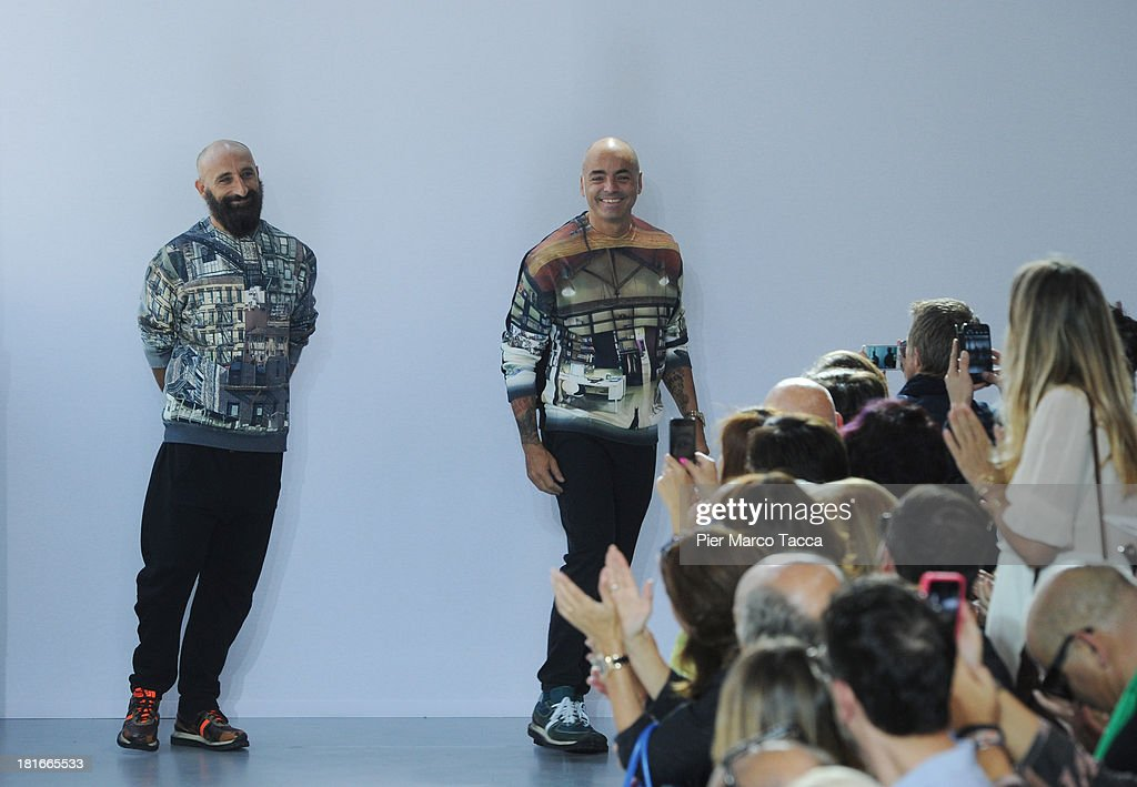Designers Pierfrancesco Gigliotti and Maurizio Modica acknowledge the applause of the audience after the Frankie Morello show as a part of Milan Fashion Week Womenswear Spring/Summer 2014 at on September 23, 2013 in Milan, Italy.