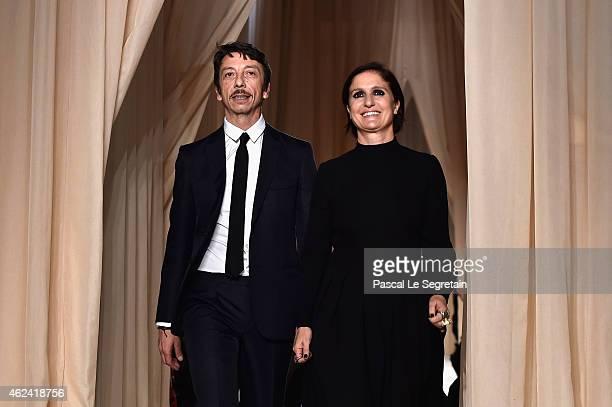 Designers Pierpaolo Piccioli and Maria Grazia Chiuri ackknowledge the public after the Valentino show as part of Paris Fashion Week Haute Couture...