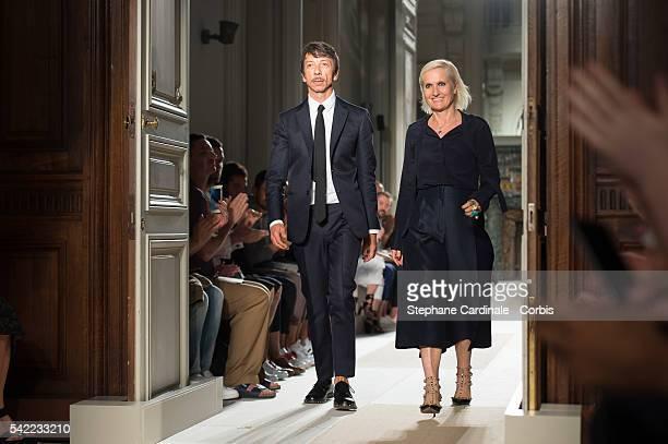 Designers Pierpaolo Piccioli and Maria Grazia Chiuri walk the runway during the Valentino Menswear Spring/Summer 2017 show as part of Paris Fashion...