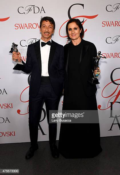 Designers Pierpaolo Piccioli and Maria Grazia pose on the winners walk at the 2015 CFDA Fashion Awards at Alice Tully Hall at Lincoln Center on June...