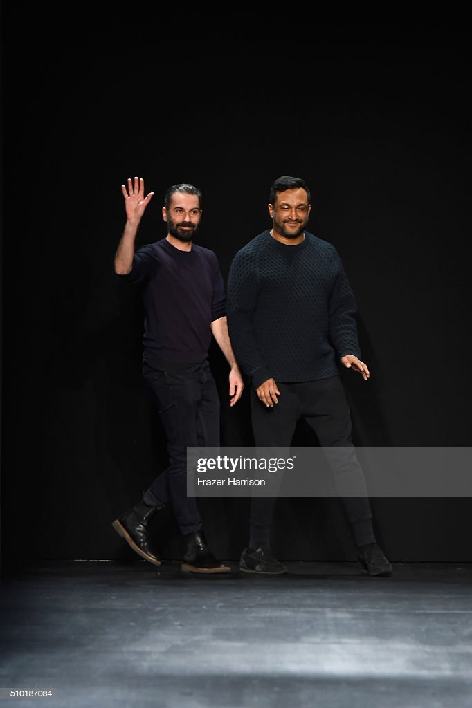 Designers Ramon Martin (L) and Ryan Lobo great the crowd from the runway at Tome Fall 2016 during New York Fashion Week: The Shows at The Dock, Skylight at Moynihan Station on February 14, 2016 in New York City.