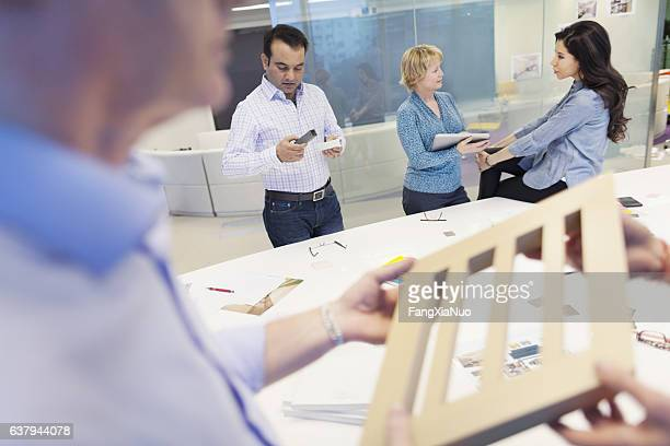 Designers reviewing product materials in studio office
