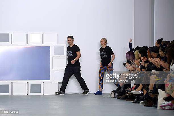 Designers Rob Jones and Catherine Teatum appear on the runway at the Teatum Jones show during London Fashion Week Spring/Summer collections 2017 on...