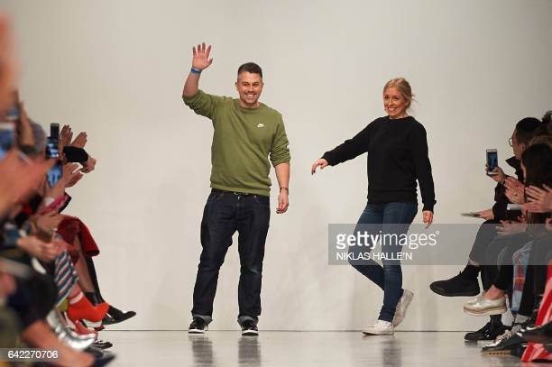 Designers Rob Jones and Catherine Teatum greets the crowd after their Teatum Jones catwalk show on the first day of the Autumn/Winter 2017 London...
