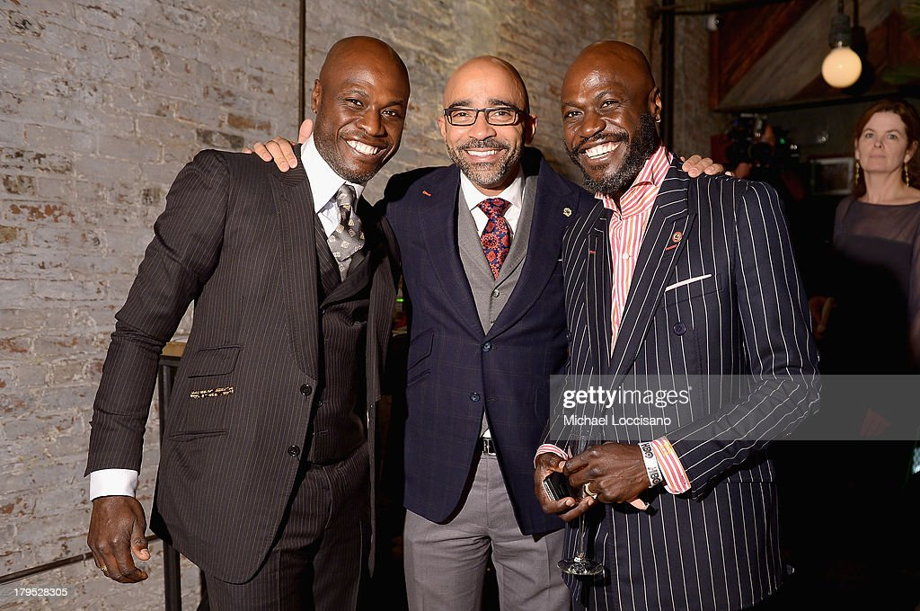 Designers Ron Delice and Ron Delice of Ron and Ron pose with Consulate General of Haiti Charles Antoine Forbin (C) at the HBO Boardwalk Empire Fashion Fete with June Ambrose at Houston Hall on September 4, 2013 in New York City.
