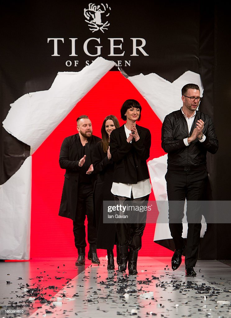 Designers Ronnie McDonald, Shena Neville, Tine Grandahl and Christian Lippich, appear on the runway during the Tiger of Sweden show at Mercedes-Benz Stockholm Fashion Week Autumn/Winter 2013 at Mercedes-Benz Fashion Pavilion on January 30, 2013 in Stockholm, Sweden.
