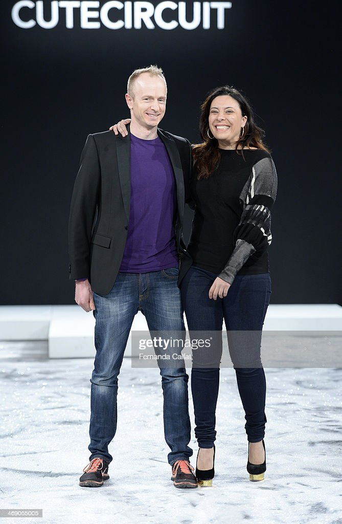 Designers Ryan Genz (L) and Francesca Rosella walk the runway at the CuteCircuit Fall 2014 fashion show during Mercedes Benz Fashion Week at The Hub at The Hudson Hotel on February 12, 2014 in New York City.