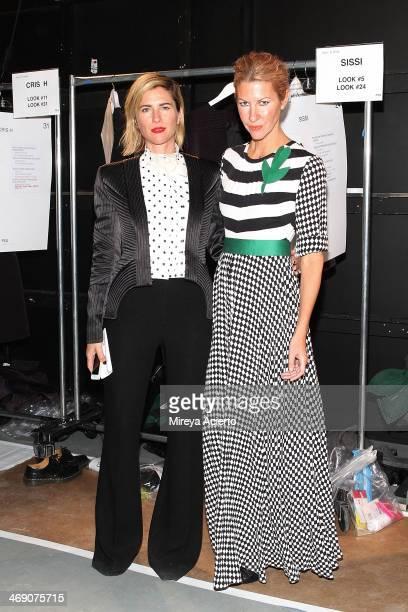Designers SarahJane Clarke and Heidi Middleton pose backstage at the Sass Bide fashion show during MercedesBenz Fashion Week Fall 2014 at The...