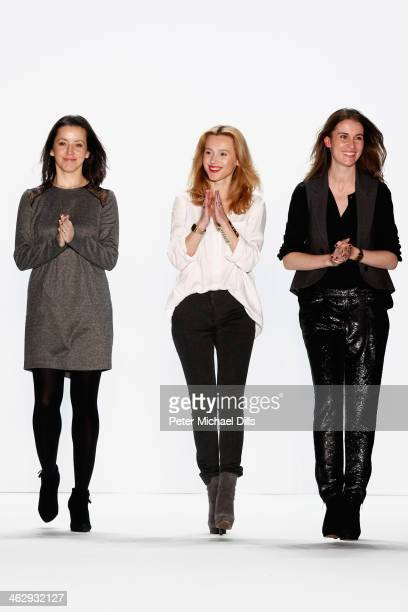 Designers Sedina Halilovic Ivana Bogicevic and Jelena Radovanovic acknowledge the audience after the Holy Ghost show during MercedesBenz Fashion Week...
