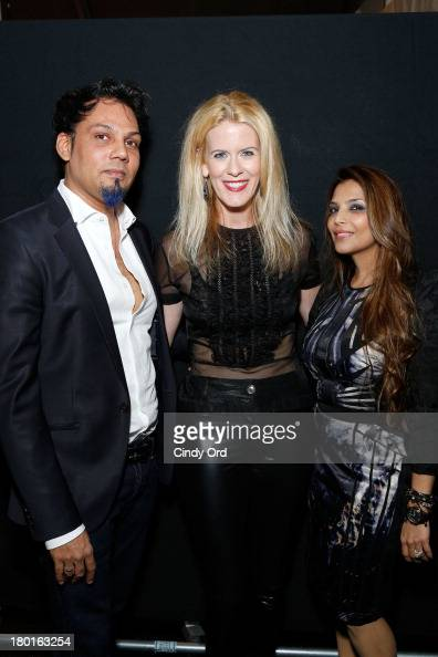 Designers Shane Peacock and Falguni Peacock pose with Alex McCord backstage at the Falguni Shane Peacock Spring Summer14 fashion show during...