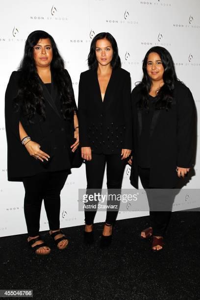 Designers Shikha Noor Al Khalifa and Shikha Haya Al Khalifa and musician Leigh Lezark pose backstage at the Noon By Noor fashion show during...