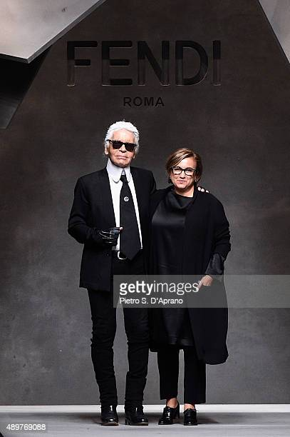 Designers Silvia Venturini Fendi and Karl Lagerfeld acknowledge the applause of the audience after the Fendi fashion show as part of Milan Fashion...