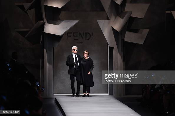 Designers Silvia Venturini Fendi and Karl Lagerfeld acknowledges the applause of the audience after the Fendi fashion show as part of Milan Fashion...