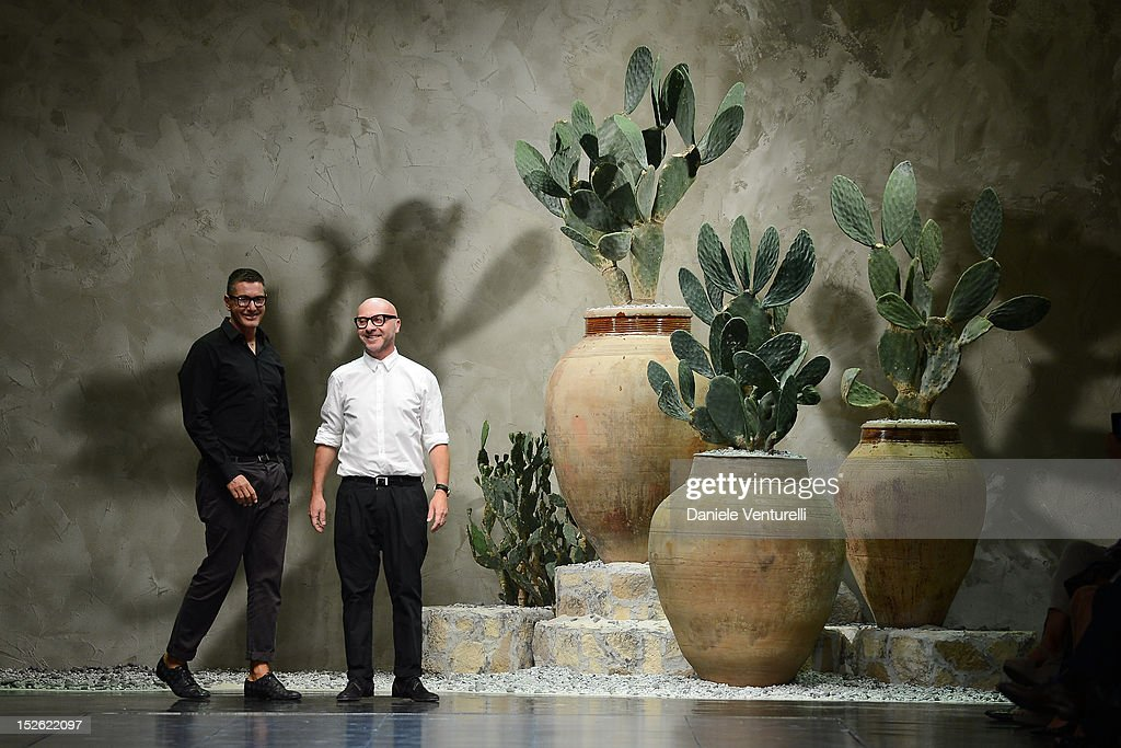 Designers <a gi-track='captionPersonalityLinkClicked' href=/galleries/search?phrase=Stefano+Gabbana+-+Fashion+Designer&family=editorial&specificpeople=4820355 ng-click='$event.stopPropagation()'>Stefano Gabbana</a> and <a gi-track='captionPersonalityLinkClicked' href=/galleries/search?phrase=Domenico+Dolce&family=editorial&specificpeople=534808 ng-click='$event.stopPropagation()'>Domenico Dolce</a> acknowledge the applause of the public after the Dolce & Gabbana Spring/Summer 2013 fashion show as part of Milan Womenswear Fashion Week on September 23, 2012 in Milan, Italy.