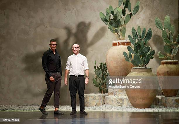 Designers Stefano Gabbana and Domenico Dolce acknowledge the applause of the public after the Dolce Gabbana Spring/Summer 2013 fashion show as part...