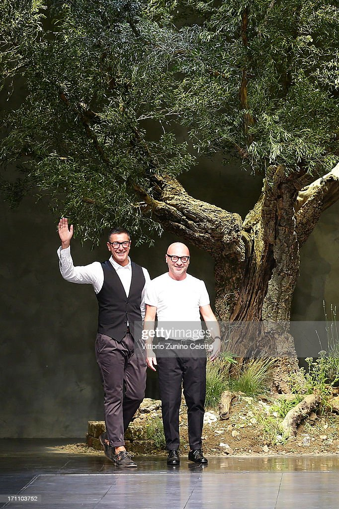 Designers <a gi-track='captionPersonalityLinkClicked' href=/galleries/search?phrase=Stefano+Gabbana+-+Fashion+Designer&family=editorial&specificpeople=4820355 ng-click='$event.stopPropagation()'>Stefano Gabbana</a> (L) and <a gi-track='captionPersonalityLinkClicked' href=/galleries/search?phrase=Domenico+Dolce&family=editorial&specificpeople=534808 ng-click='$event.stopPropagation()'>Domenico Dolce</a> acknowledge the applause of the audience after the Dolce & Gabbana show during Milan Menswear Fashion Week Spring Summer 2014 on June 22, 2013 in Milan, Italy.