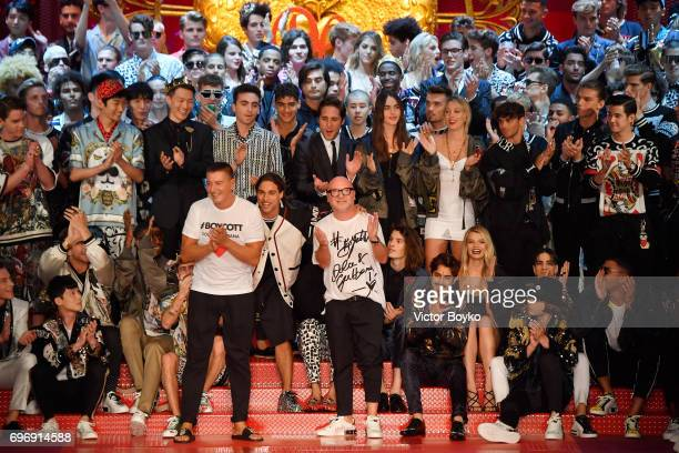 Designers Stefano Gabbana and Domenico Dolce acknowledge the applause of the audience at the Dolce Gabbana show during Milan Men's Fashion Week...