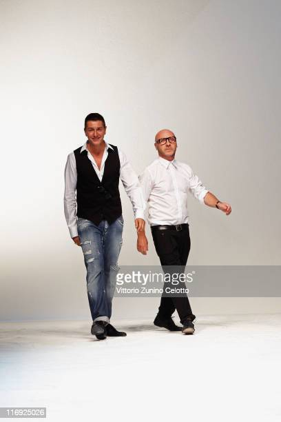 Designers Stefano Gabbana and Domenico Dolce acknowledge the audience at the end of the Dolce Gabbana fashion show as part of Milan Fashion Week...