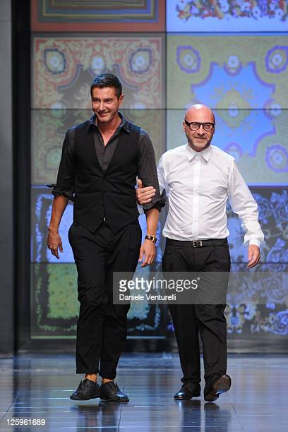 Designers Stefano Gabbana and Domenico Dolce acknowledge the audience at the end of the DG fashion show as part of Milan Fashion Week Womenswear...