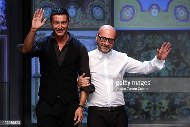 Designers Stefano Gabbana and Domenico Dolce acknowledge the audience at the end of the last DG fashion show as part of Milan Fashion Week Womenswear...