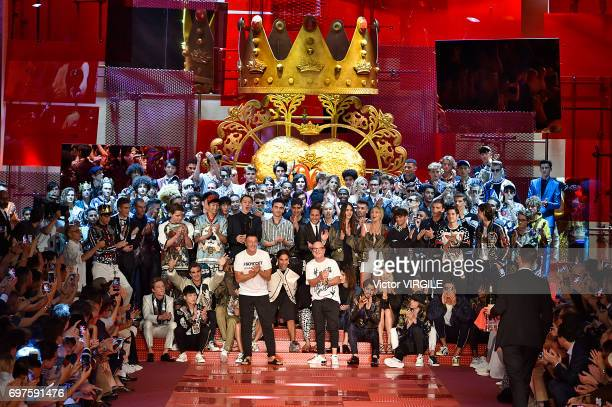 Designers Stefano Gabbana and Domenico Dolce walk the runway at the Dolce Gabbana show during Milan Men's Fashion Week Spring/Summer 2018 on June 17...