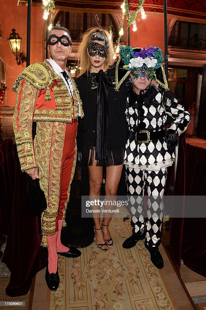 Designers Stefano Gabbana, Bianca Brandolini D'Adda and Domenico Dolce attend the 'Ballo in Maschera' to Celebrate Dolce&Gabbana Alta Moda at Palazzo Pisani Moretta on July 6, 2013 in Venice, Italy.