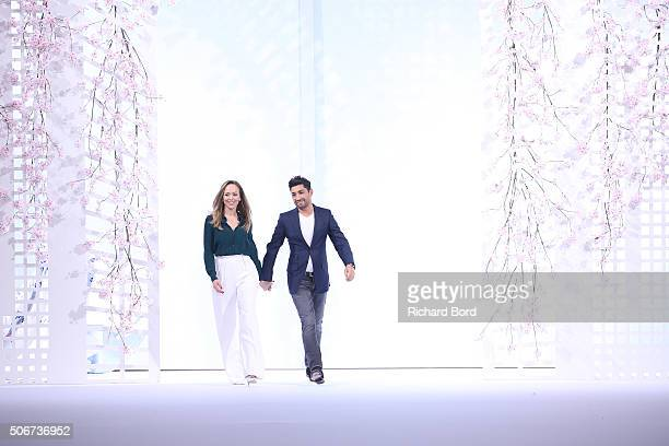 Designers Tamara Ralph and Michael Russo salute the audience after the Ralph Russo Spring Summer 2016 show as part of Paris Fashion Week on January...