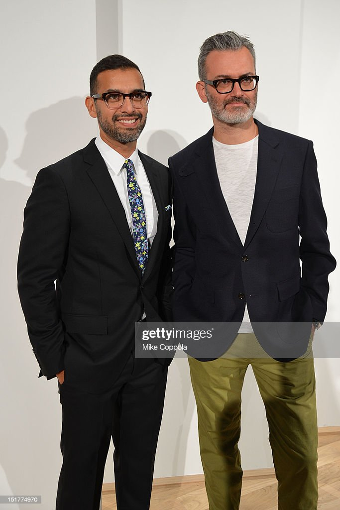 Designers Tom Mora and Frank Muytjens pose at the J.Crew Presentation during the Spring 2013 Mercedes-Benz Fashion Week at The Studio at Lincoln Center on September 11, 2012 in New York City.