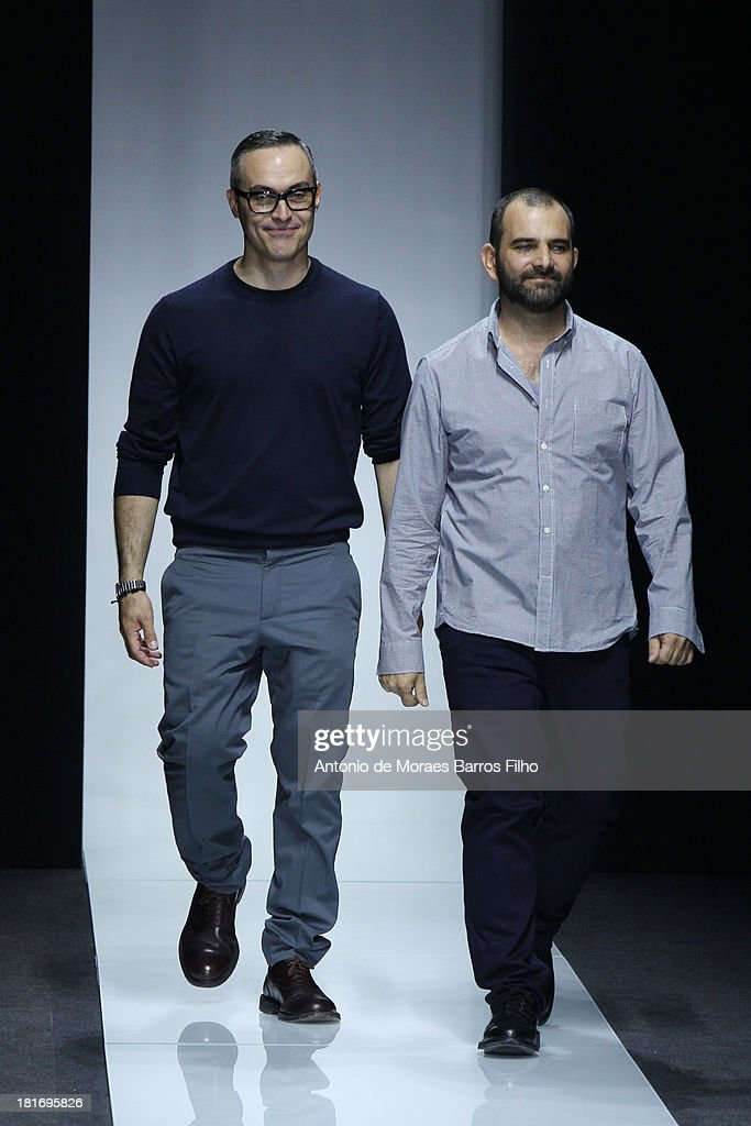 Designers Tommaso Aquilani and Roberto Rimondi walk the runway at the Gianfranco Ferre show as part of Milan Fashion Week Womenswear Spring/Summer 2014 on September 23, 2013 in Milan, Italy.
