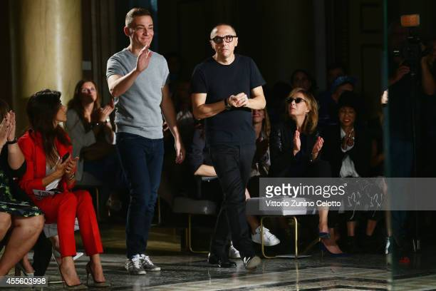 Designers Tommaso Aquilano and Roberto Rimondi acknowledge the applause of the audience after the Fay show as part of Milan Fashion Week Womenswear...