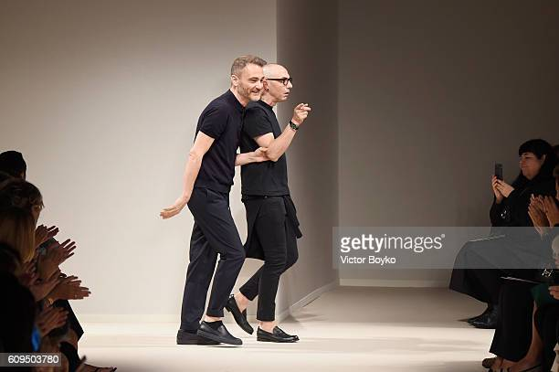 Designers Tommaso Aquilano and Roberto Rimondi acknowledge the applause of the audience after the Fay show during Milan Fashion Week Spring/Summer...