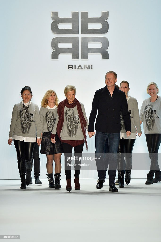 Designers Ulrich Schulte and Isi Degel acknowledge the audience at the Riani show during Mercedes-Benz Fashion Week Autumn/Winter 2014/15 at Brandenburg Gate on January 14, 2014 in Berlin, Germany.