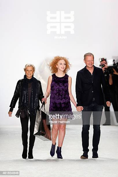 Designers Ulrich Schulte Isi Degel and model Anna Ermakova walk the runway at the Riani show during the MercedesBenz Fashion Week Berlin...