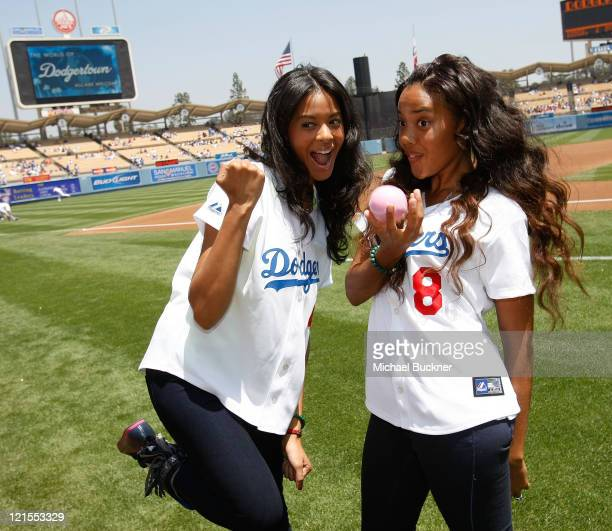 Designers Vanessa Simmons and Angela Simmons throw out the first pitch at Dodger Stadium on May 9 2009 in Los Angeles California