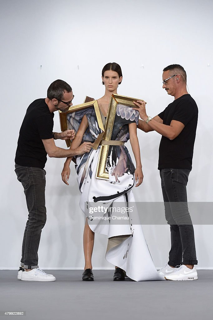 Designers Viktor Horsting and Rolf Snoeren undressed a model during the Viktor&Rolf show as part of Paris Fashion Week Haute Couture Fall/Winter 2015/2016 on July 8, 2015 in Paris, France.