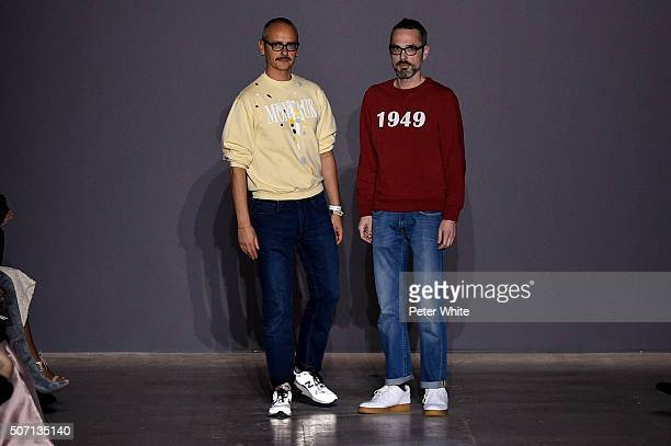 Designers Viktor Horsting and Rolf Snoeren walk the runway during the ViktorRolf Spring Summer 2016 show as part of Paris Fashion Week on January 27...