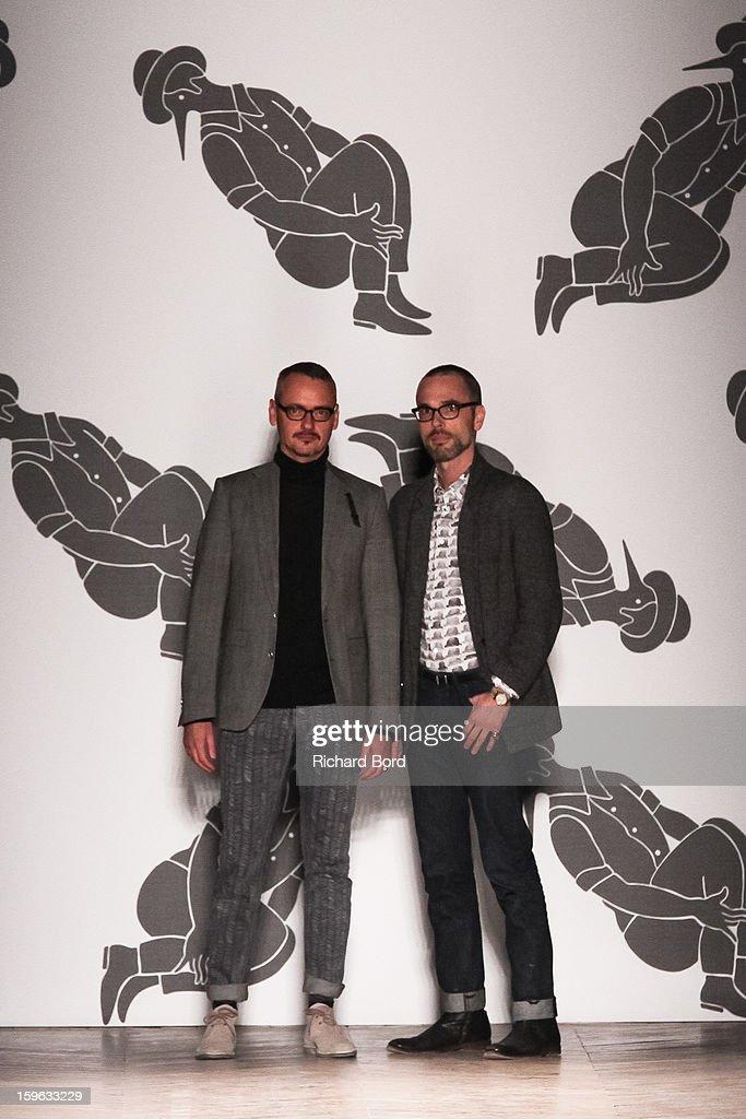 Designers Viktor Horsting and Rolf Snoeren walks the runway during the Viktor&Rolf Men Autumn / Winter 2013 show as part of Paris Fashion Week on January 17, 2013 in Paris, France.