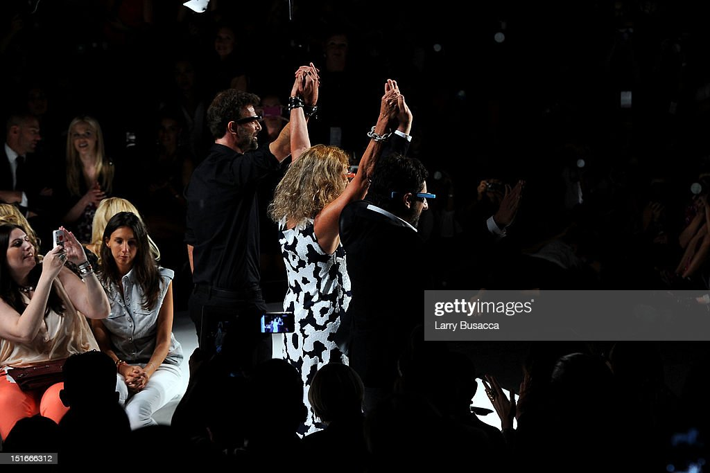 Designers Yvan Mispelaere and Diane Von Furstenberg and Google co-founder Sergey Brin walk the runway at the Diane Von Furstenberg Spring 2013 fashion show during Mercedes-Benz Fashion Week at The Theatre at Lincoln Center on September 9, 2012 in New York City.
