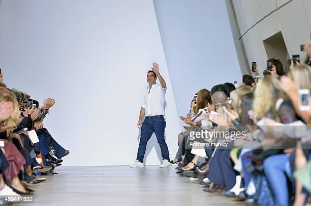 Designre Antonio Berardi salutes the crowd following the Antonio Berardi show during London Fashion Week Spring/Summer 2016 on September 21 2015 in...