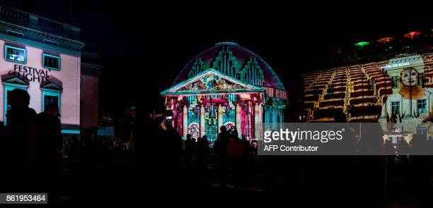 Designs are projected on the facades of the Staatsoper St Hedwig's Cathedral and the Hotel de Rome on the last day of the yearly Festival of Lights...