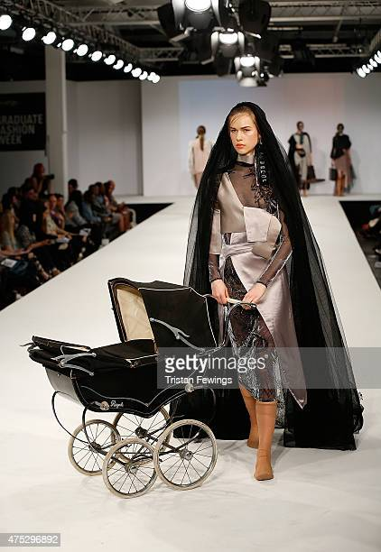Designs by Tian Wang of Ravensbourne College on day 1 of Graduate Fashion Week at The Old Truman Brewery on May 30 2015 in London England
