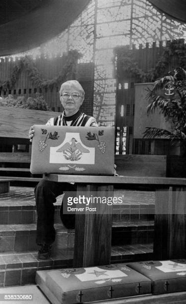 Designs In Needlepoint Mary Jo of Littleton United Methodist Church holds up one of 30 kneelers done in needlepoint by women of the church The...