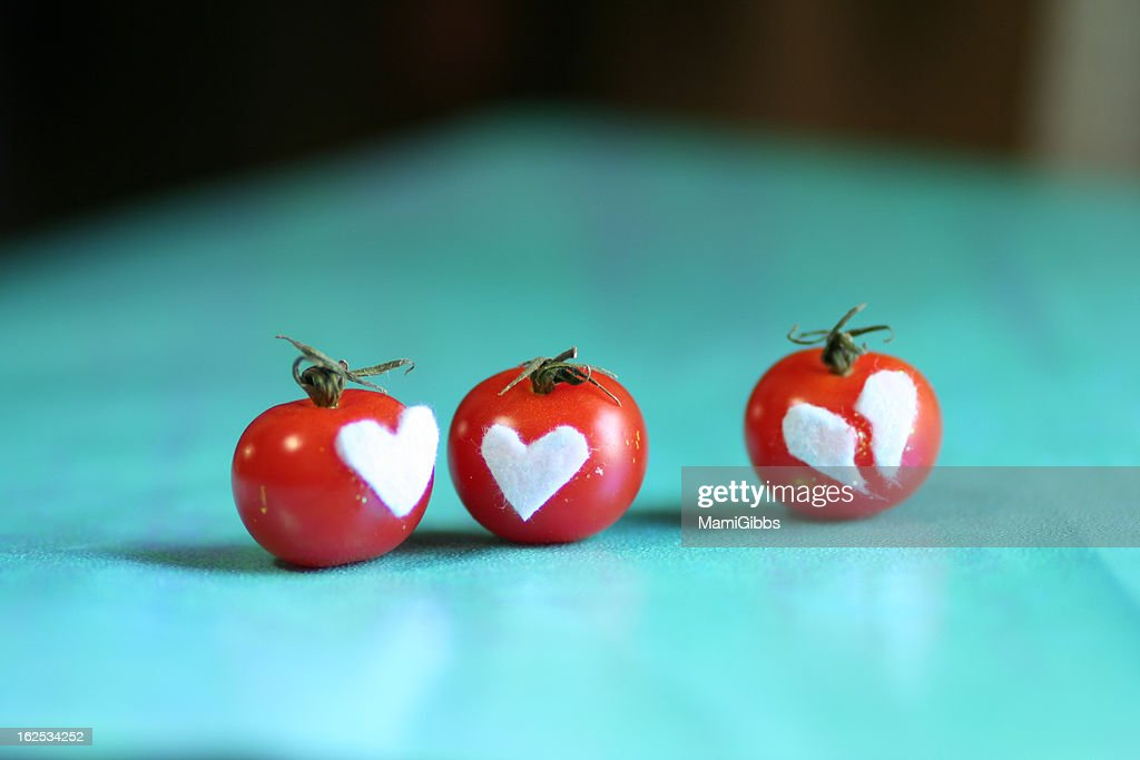 DesignTomatoes with a broken heart and love : Stock Photo