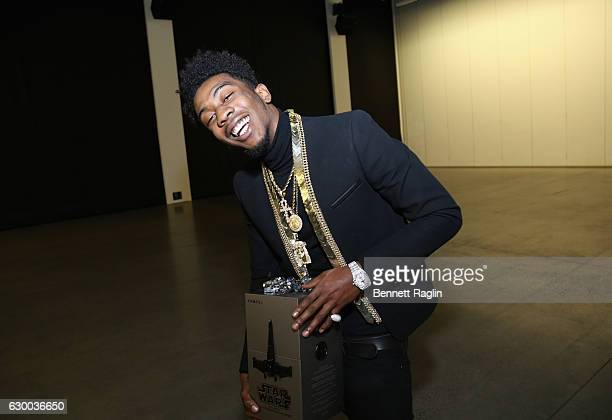 Desiigner poses with Propel Star Wars Battle Drones at Def Jam's Holiday Party on December 15 2016 in New York City