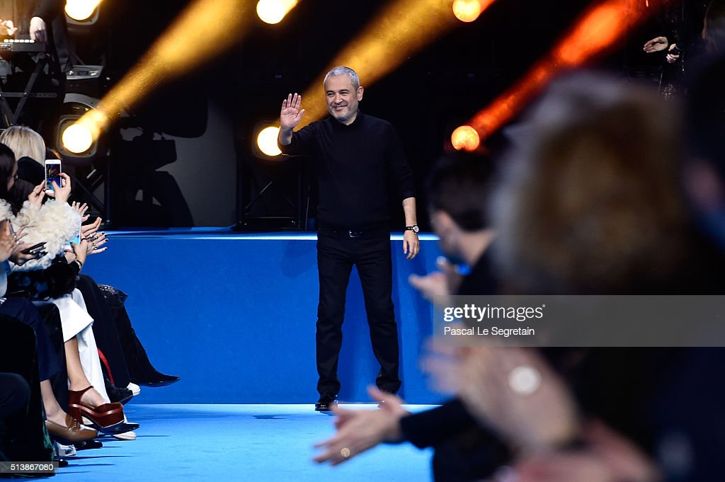 Desiner <a gi-track='captionPersonalityLinkClicked' href=/galleries/search?phrase=Elie+Saab+-+Modedesigner&family=editorial&specificpeople=4979945 ng-click='$event.stopPropagation()'>Elie Saab</a> poses on the runway during the <a gi-track='captionPersonalityLinkClicked' href=/galleries/search?phrase=Elie+Saab+-+Modedesigner&family=editorial&specificpeople=4979945 ng-click='$event.stopPropagation()'>Elie Saab</a> show as part of the Paris Fashion Week Womenswear Fall/Winter 2016/2017 on March 5, 2016 in Paris, France.