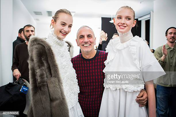 Desinger Alessandro Dell' Acqua and models pose backstage ahead of the N°21 show during the Milan Fashion Week Autumn/Winter 2015 on February 25 2015...