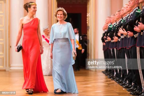 Desirée Kogevinas and Madeleine Kogevinas of Sweeden arrive for a gala dinner at the Royal Palace in Oslo Norway on May 9 2017 to mark the 80th...