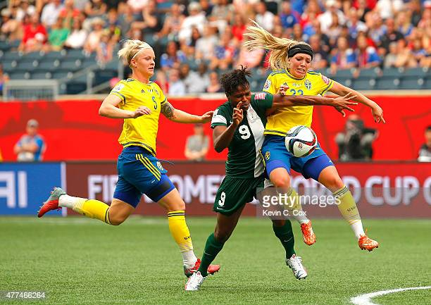 Desire Oparanozie of Nigeria against Elin Rubensson of Sweden during the FIFA Women's World Cup Canada 2015 Group D match between Sweden and Nigeria...