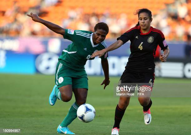 Desire Oparanozie of Nigeria and Bianca Sierra of Mexico battle for the ball during the FIFA U20 Women's World Cup Japan 2012 Quarter Final match...